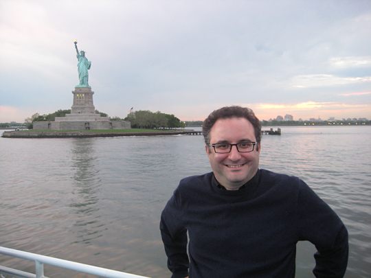 Sam Greenfield in front of the Statue of Liberty