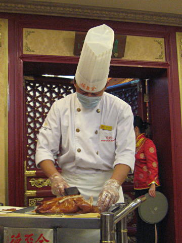 Chef preparing Peking duck