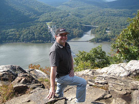 Sam Greenfield overlooking Bear Mountain Bridge from Anthony's Nose