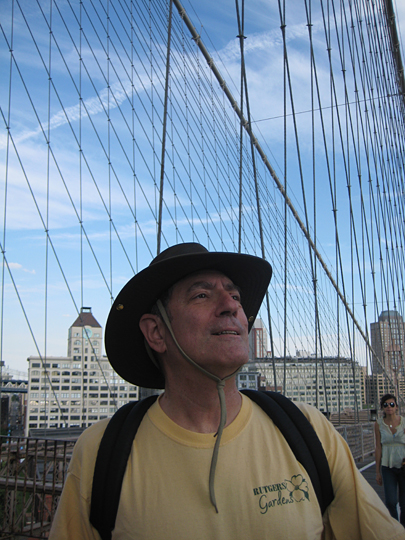 Stephen Greenfield walking over the Brooklyn Bridge